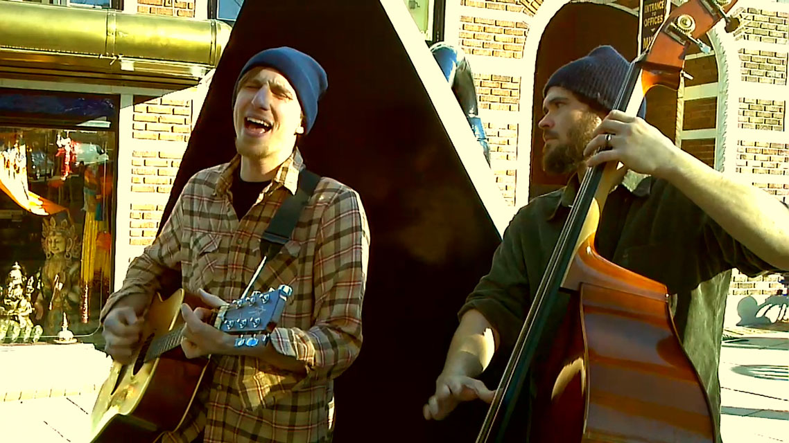 "Busk Break: The Asheville Waits Band covers ""Jockey Full of Bourbon"""